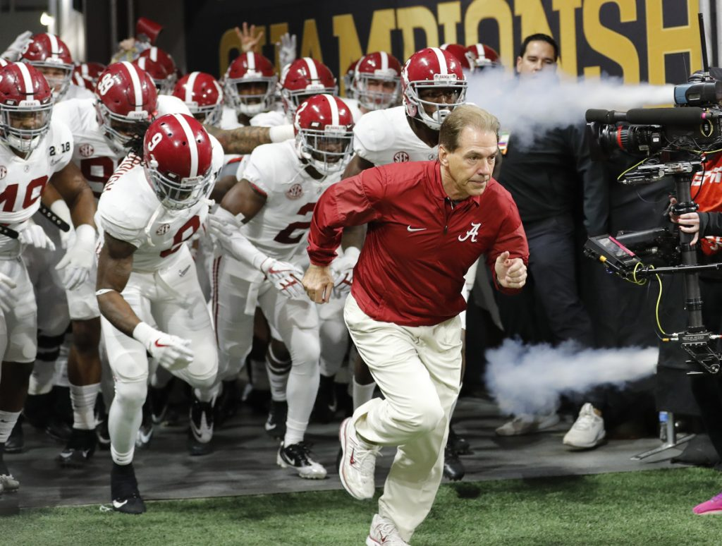 Alabama head coach Nick Saban leads his team on the field before the NCAA college football playoff championship game against Georgia in January in Atlanta.