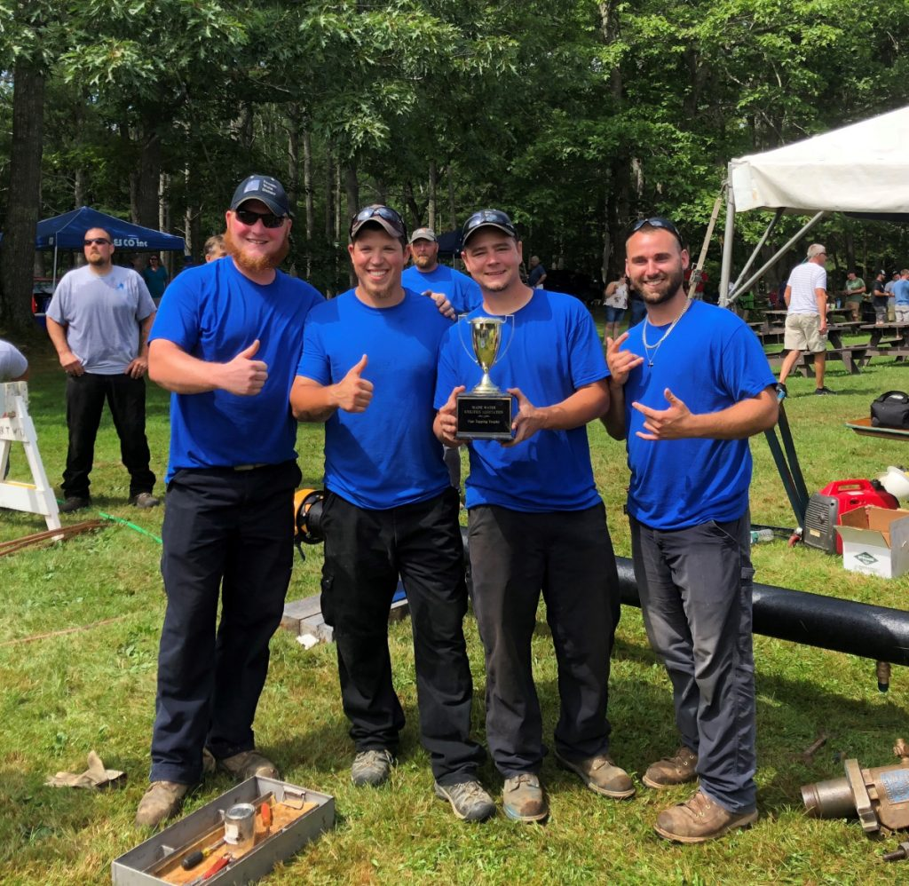 The Kennebec Water District team took first place in the second annual Pipe Tapping Competition held Aug. 9 at Thomas Point Beach in Brunswick. From left are TJ Pooler, Tony Bellavance, Shane George and Ross Desjardins.
