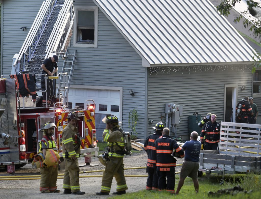 Firefighters from several communities extinguish a blaze Tuesday at a residence on Indiana Road in West Gardiner.