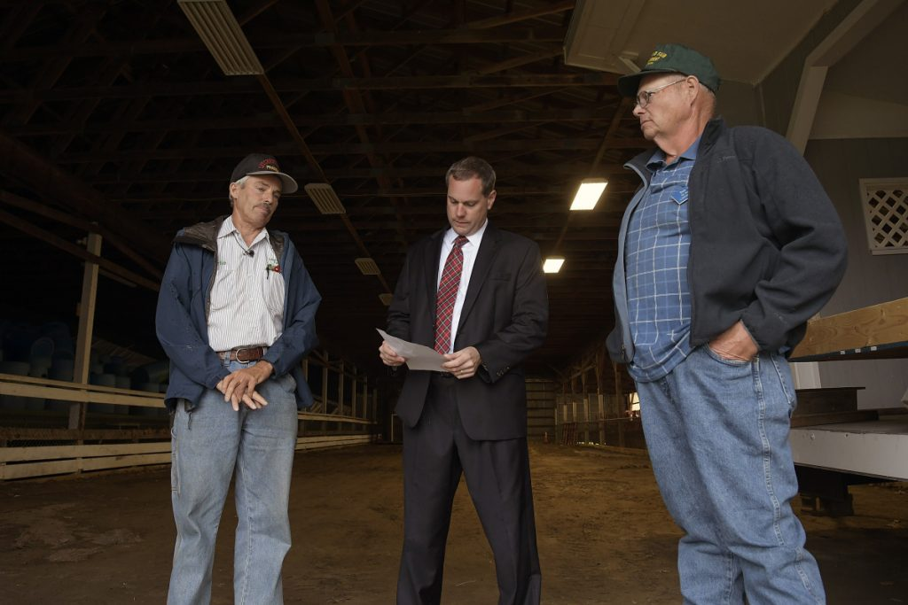 Litchfield Fair President Charlie Smith, left, attorney Kevin Sullivan and First Vice President Dick Brown assert Wednesday that about $80,000 is missing from the fair's bank accounts.
