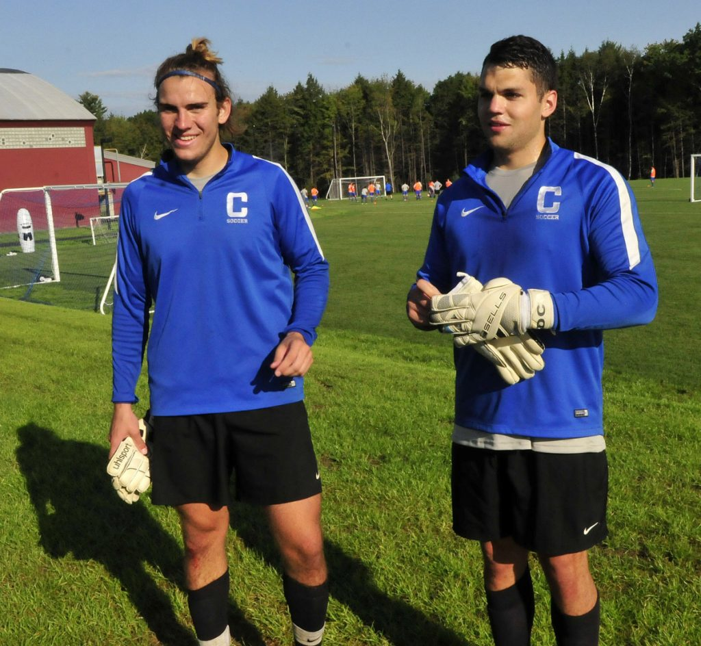 Colby College goalies Stanley Clarke, left, and Dan Carlson talk about the new athletics fields during a practice last September. Carlson, Clarke and the Mules will open the season Sept. 5 at Thomas College.