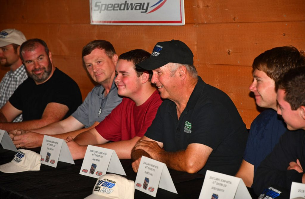 Photo by Norm Marx/Pro All Stars Series   From left to right, Johnny Clark, Tim Brackett, Gabe Brown, Mike Rowe, Garrett Hall and Derek Griffith answer questions from the media during Oxford 250 Media Day on Wednesday at the Honey Badger Bar & Grill next to Oxford Plains Speedway in Oxford.