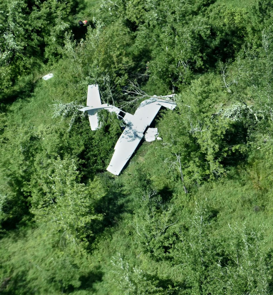 The twisted fuselage of a U.S. Customs and Border Protection airplane lies near the Sebasticook River in Burnham on Thursday, close to Pittsfield Municipal Airport. The plane, with two people on board, crashed around 11 p.m. Wednesday, injuring the two occupants.