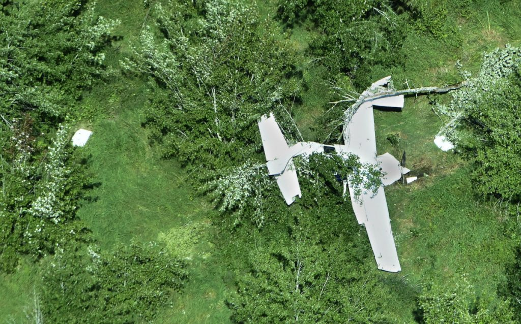 The twisted fuselage of a U.S. Customs and Border Protection airplane lies near the Sebasticook River in Burnham on Thursday, close to Pittsfield Municipal Airport. The plane crashed around 11 p.m. Wednesday, injuring its two occupants.