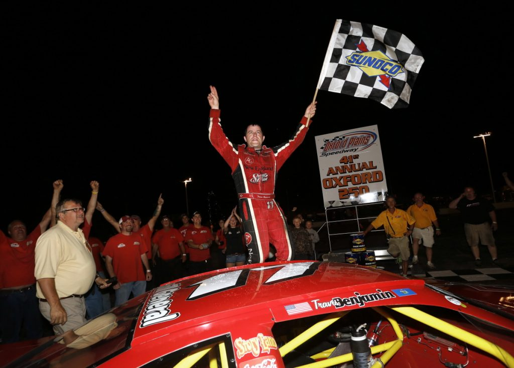Travis Benjamin of Morrill celebrates after winning the Oxford 250 for the second consecutive year in 2014.
