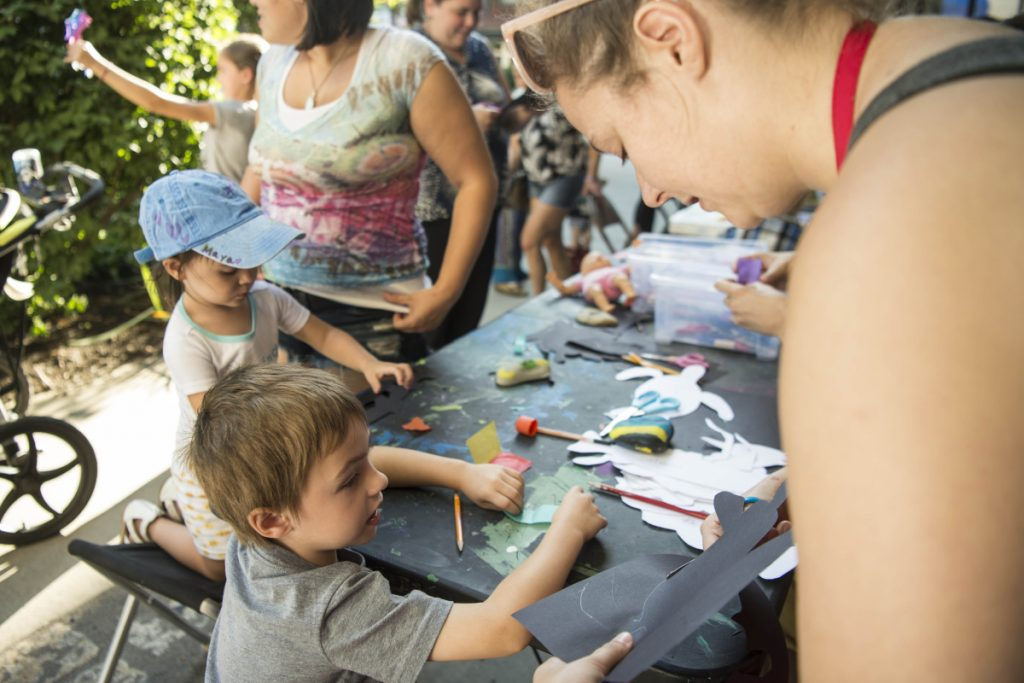 CJ Bernardini, 4, gets help on his art project Thursday from Dianna Wendell, right, at Common Street Arts at The Center at Castonguay Square in downtown Waterville. Waterville Creates! and Common Street Arts are moving temporarily to the Hathaway Creative Center to make way for long-term changes at The Center on Main Street.
