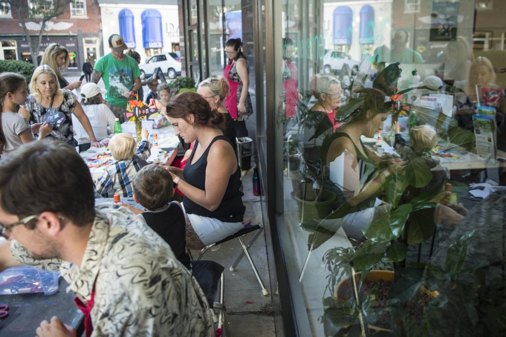 Children with their parents work on arts and crafts Thursday at Common Street Arts at The Center at Castonguay Square in downtown Waterville. Waterville Creates! and Common Street Arts are moving temporarily to the Hathaway Creative Center to make way for long-term changes at The Center on Main Street.