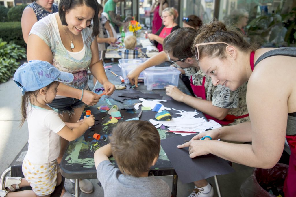 Maya Bernardini, 2, left, and her big brother CJ, 4, center, work on arts and crafts Thursday with their mother, Erika Bernardini, back left, and Dianna Wendell, right, an educator at Common Street Arts, during an art party at The Center at Castonguay Square in downtown Waterville. Waterville Creates! and Common Street Arts are moving temporarily to the Hathaway Creative Center to make way for long-term changes at The Center on Main Street.