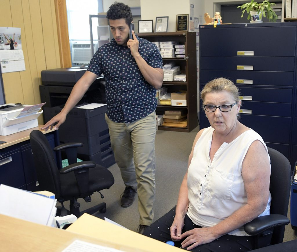 Dresden Clerk and Treasurer Shirley Storkson and administrative assistant Michael Henderson work Tuesday at the Dresden Town Hall.