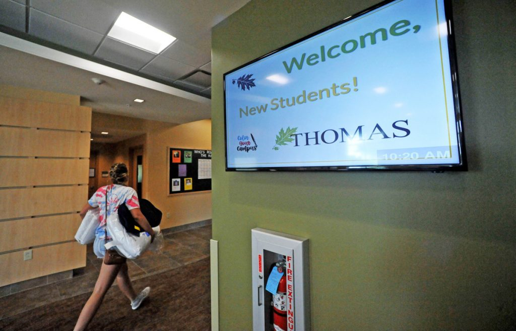 A new Thomas College student moves her belongings into her dormitory room in 2017 at Hinman Hall in Waterville.