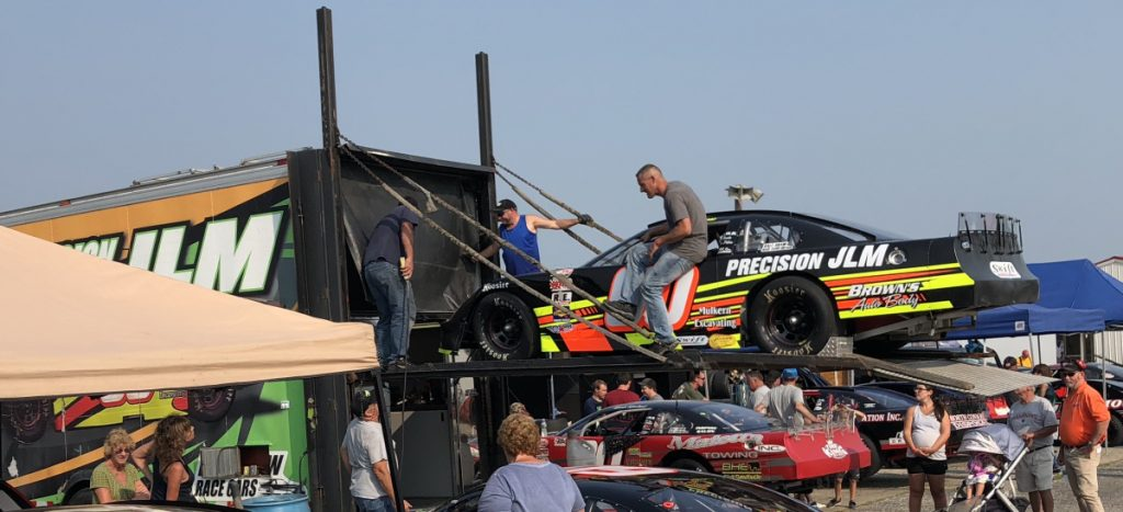 Crew members load the D.J. Shaw's No. 60 car following Oxford 250 practice Friday at Oxford Plains Speedway. Shaw, of Center Conway, New Hampshire, is the current Pro All Stars Series point leader.