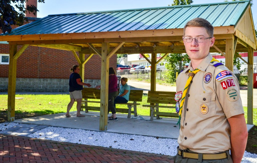 Alex Stewart is seen Thursday with a new outdoor classroom at Lincoln School in Augusta. Stewart organized the classroom's construction as part of an Eagle Scout project. Stewart, of Augusta, is a Life Scout and member of Boy Scout Troop 479 in China.