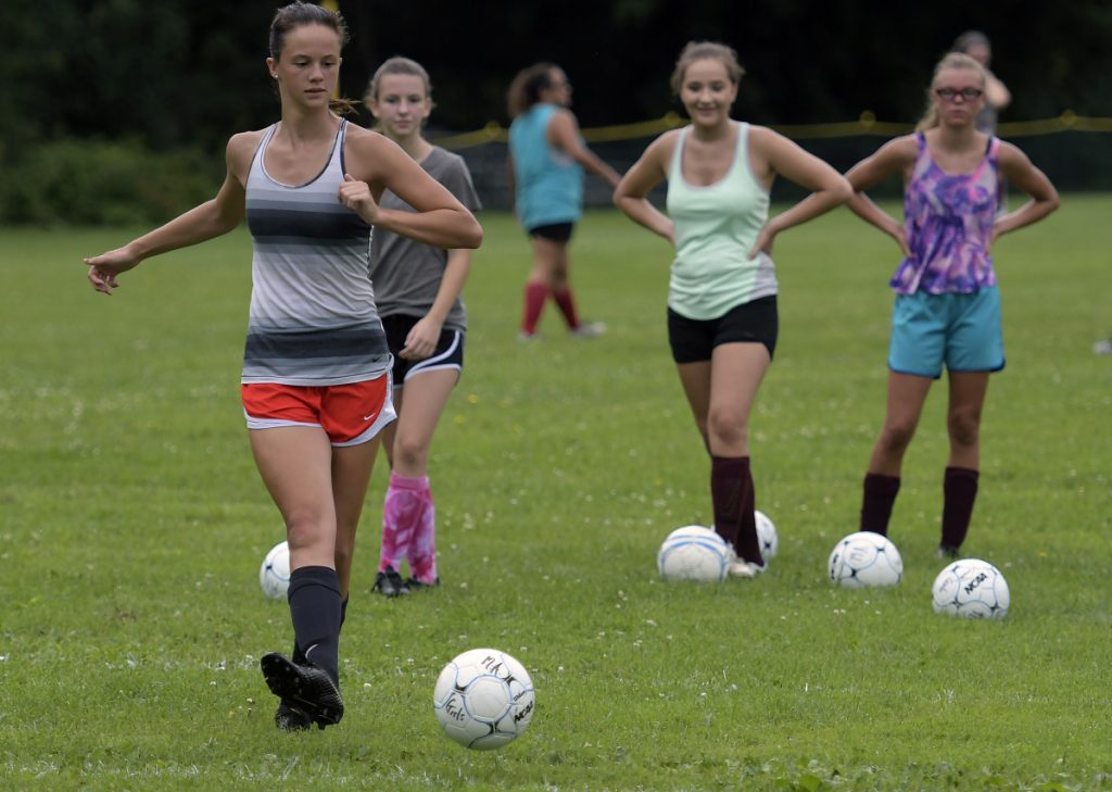Members of the Monmouth girls soccer team works on drills during an Aug. 15 practice in Monmouth.