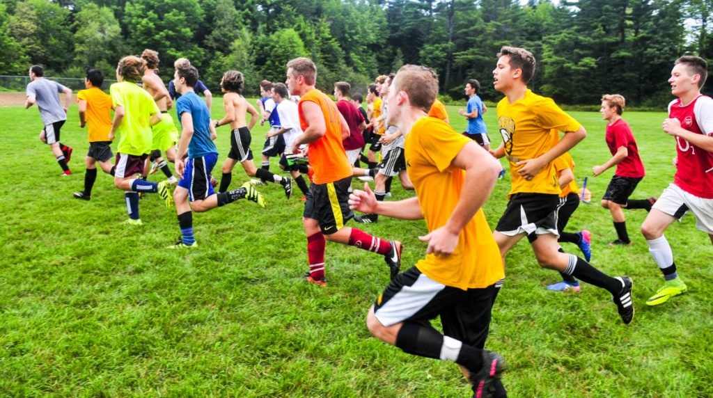 Staff photo by Andy Molloy Maranacook boys soccer players run during an early morning practice on Aug. 16 in Readfield.