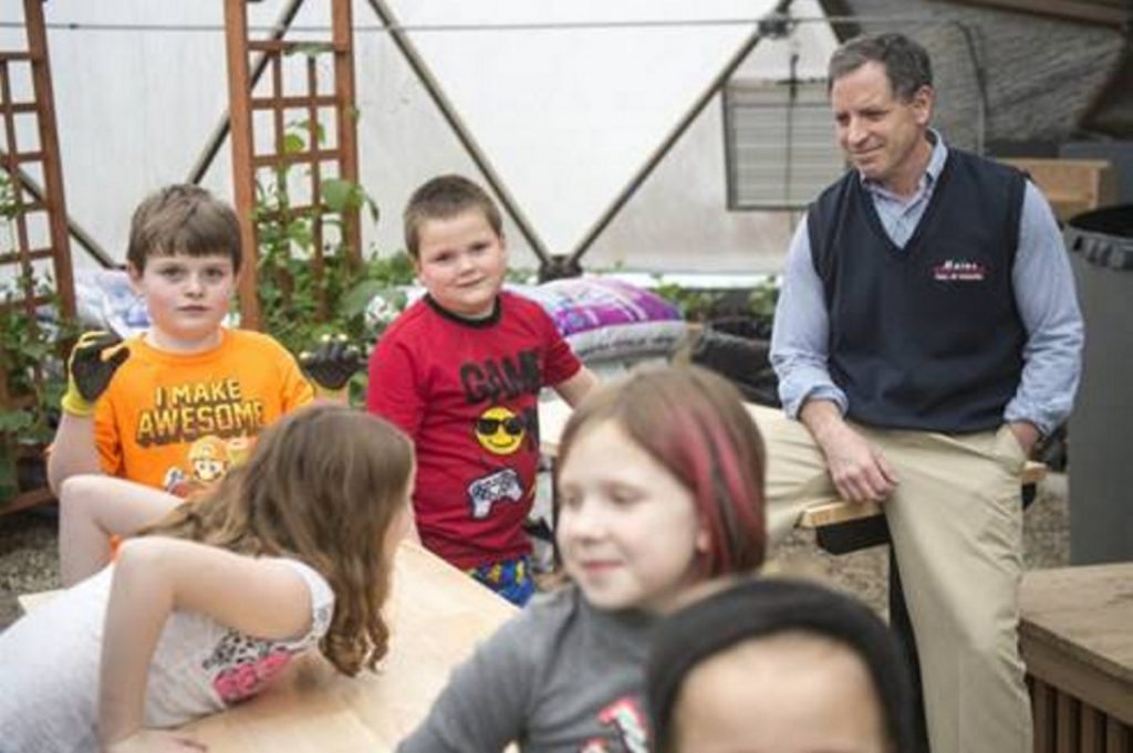 Garden to Table program participants, in front, from left, Emma Chaput, 8, Emma Gallagher, 6, Lahla Brann, 7, and in back, from left, Anderson Phinney, 8, and Xavier Bernardini, 7, with CEO Ken Walsh, Alfond Youth Center in Waterville.