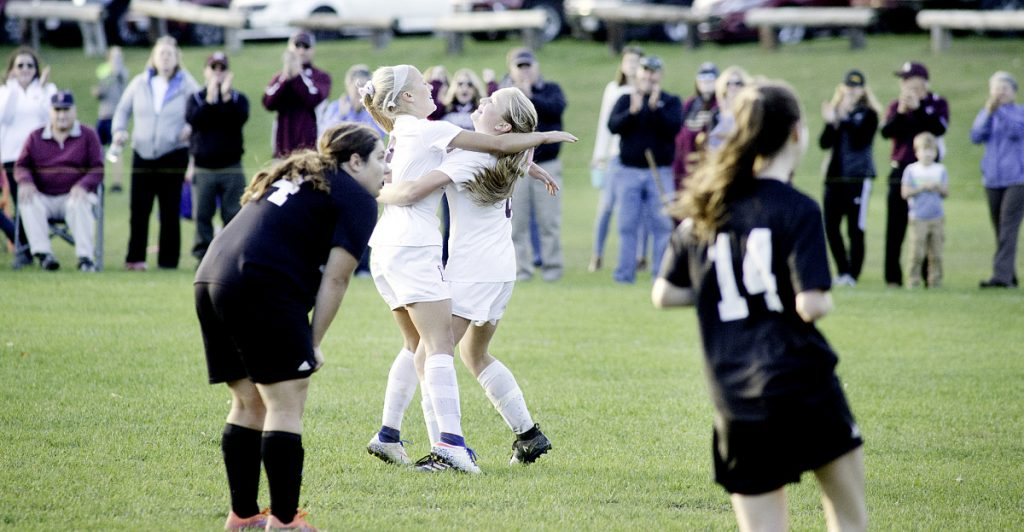 Big goal: Monmouth's Audrey Fletcher, center left, celebrates with teammate Alicen Burnham after Burnham scored a goal against St. Dominic in a Class C South semifinal game last season in Monmouth.