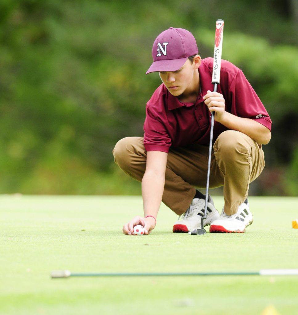 Staff file photo by Joe Phelan   Easy does it: Nokomis' Sam Smestad lines up a putt during the team state golf championships last season at Natanis Golf Course in Vassalboro.