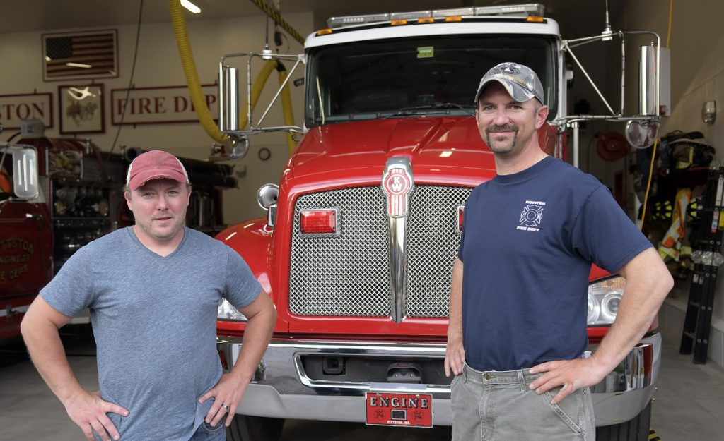 Josh Johnson, left, and Jason Farris at the Pittston Fire Department on Tuesday. Johnson has been promoted to chief of the department with Farris's stepping down from the position with the volunteer company.