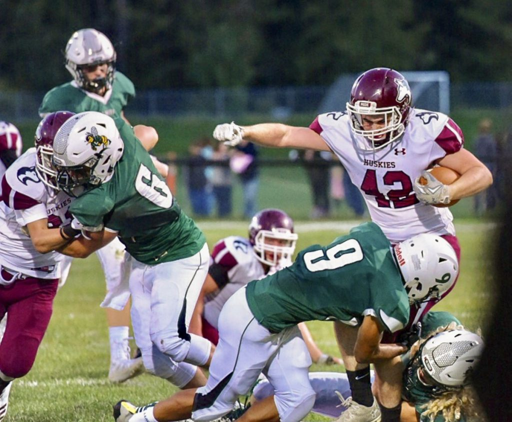 Maine Central Institute's Tucker Sharples gets tackled by Leavitt's Damion Calder during the season opener Friday night in Turner.