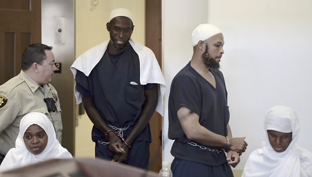 Defendants, from left, Jany Leveille, Lucas Morton, Siraj Wahhaj and Subbannah Wahhaj enter district court in Taos, N.M., for a detention hearing Monday. Several defendants have been charged with child abuse stemming from the alleged neglect of 11 children found living on a squalid compound on the outskirts of tiny Amalia, New Mexico.