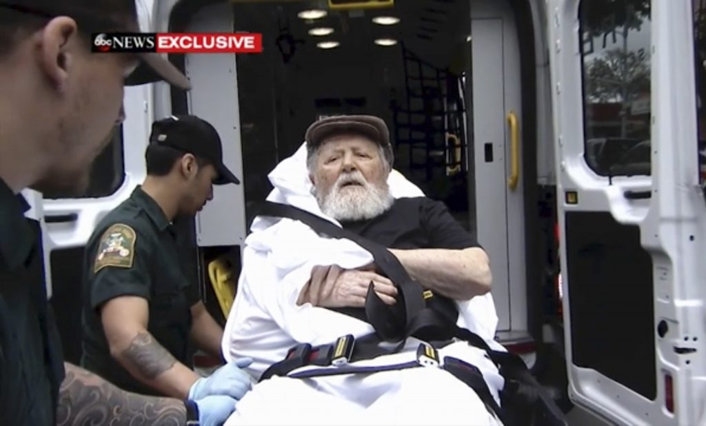 In this Monday, Aug. 20, 2018, frame from video, Jakiw Palij, a former Nazi concentration camp guard, is carried on a stretcher from his home into a waiting ambulance in the Queens borough of New York. Palij, the last Nazi war crimes suspect facing deportation from the U.S. was taken from his home and spirited early Tuesday morning to Germany, the White House said.