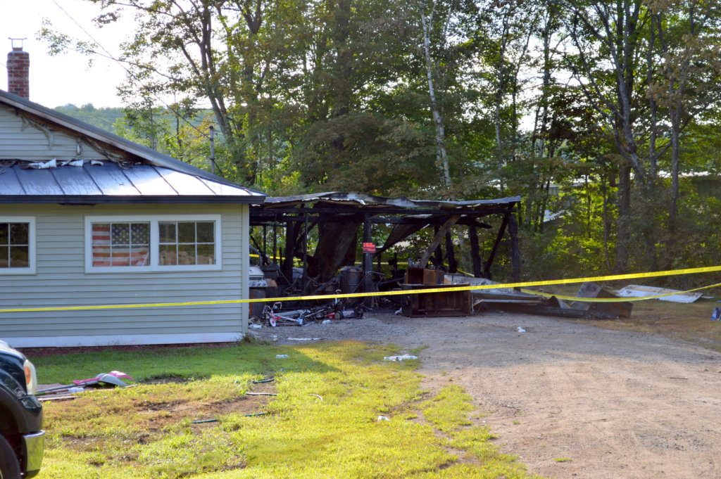 A fire destroyed a house and attached garage on Saturday night at 287 Middle St. in Farmington. John and Angela Whelpley and children escaped safely from the home, Farmington Fire Rescue Capt. Scott Baxter said Monday. The property is about 50 yards from the Regional School Unit 9 bus garage which can be seen through the trees on right.