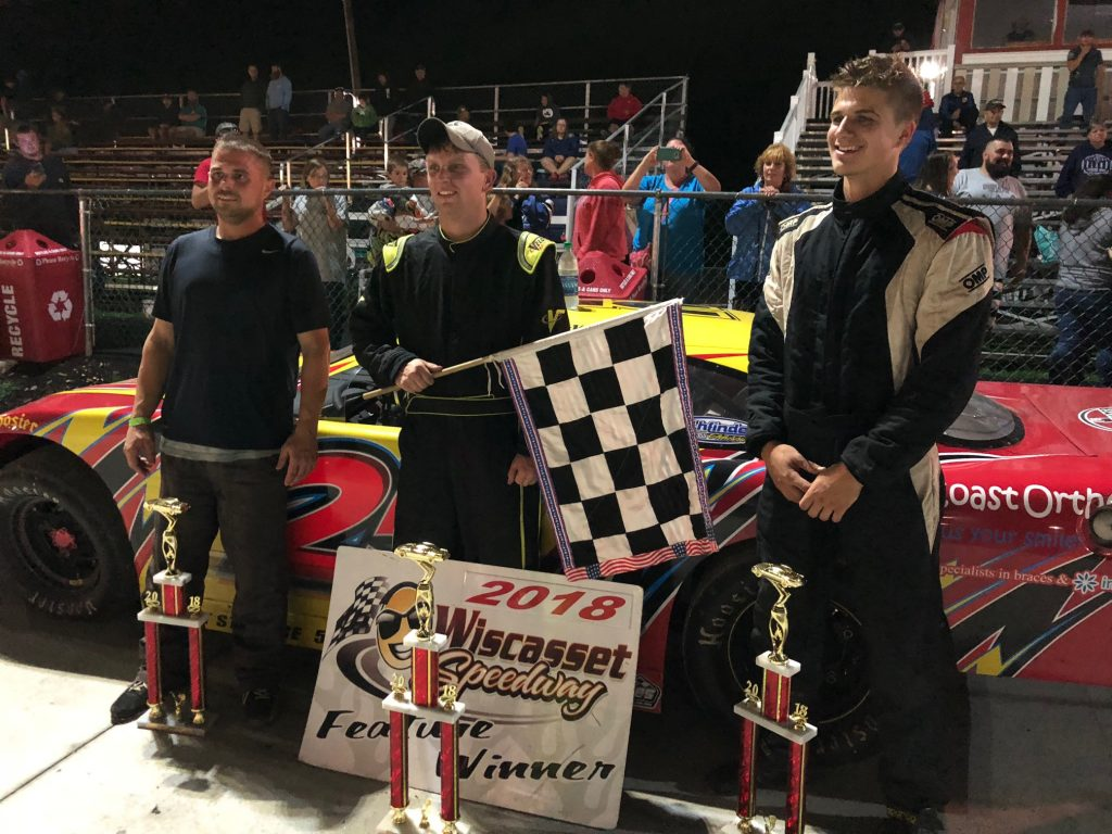Will Collins, center, stands with Andrew McLauglin, left, and James Baker in victory lane at Wiscasset Speedway on Saturday.
