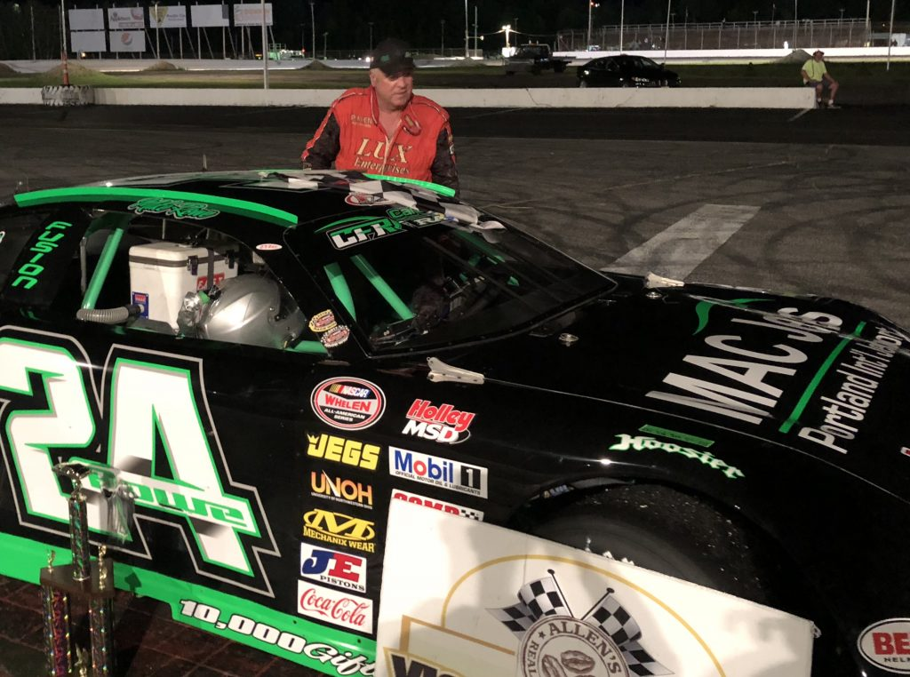 Mike Rowe of Turner climbs out of his car after winning the Super Late Model feature Saturday night at Oxford Plains Speedway in Oxford.