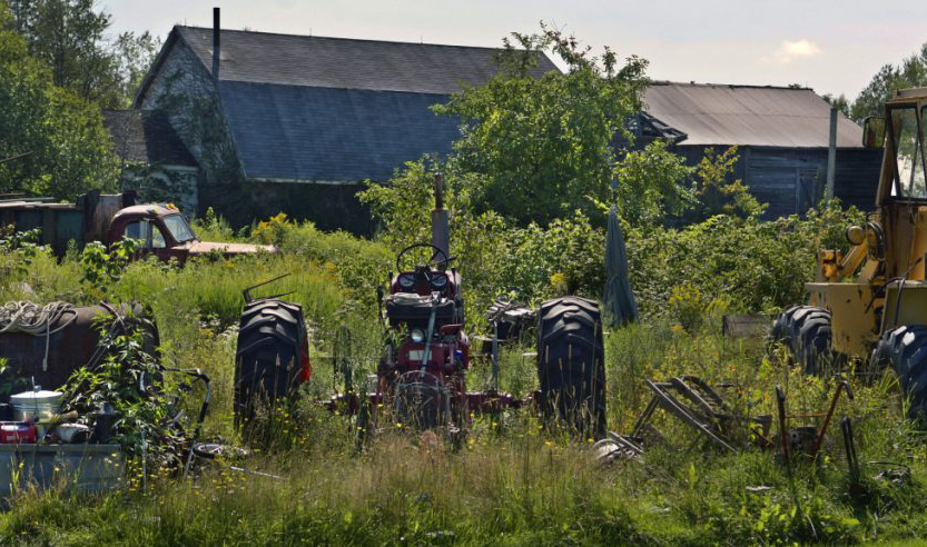 A variety of objects lie on the lawn Tuesday at a residence on Alexander Reed Road in Richmond. A court has ruled that the property is an illegal junkyard.