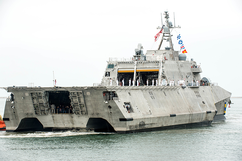 Sailors man the rails as the Independence-variant littoral combat ship USS Manchester (LCS 14) sails into Naval Base San Diego for the first time.
