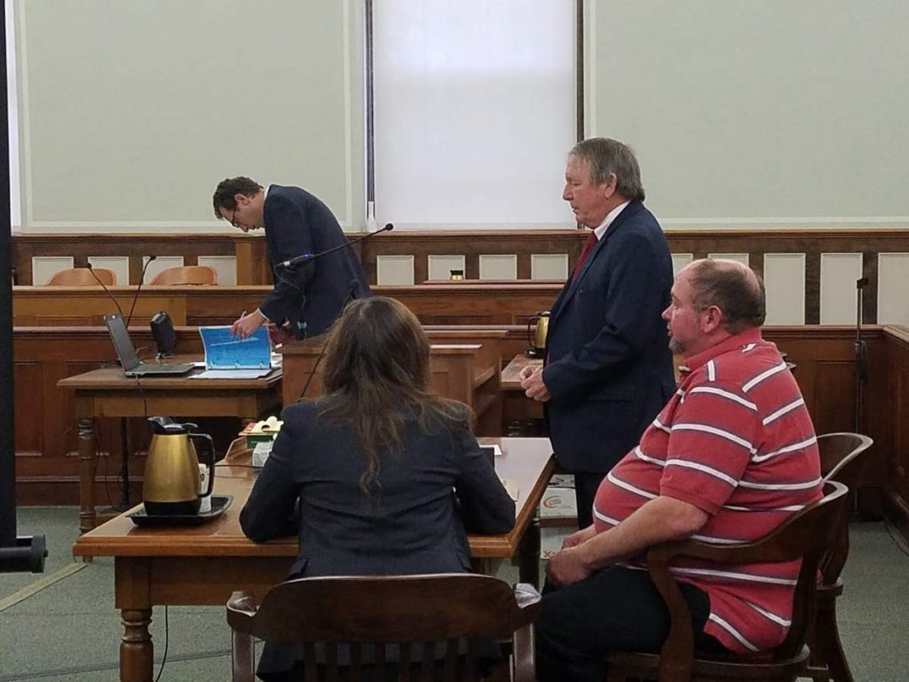 Alan B. Norwood Jr., right, is being sued over the sinking of a lobster boat owned by Joshua Hupper of Tenants Harbor. Norwood is pictured here during a criminal trial held in October 2017. He was acquitted of the criminal charge of aggravated criminal mischief for allegedly paying his sternman to sink Hupper's boat.