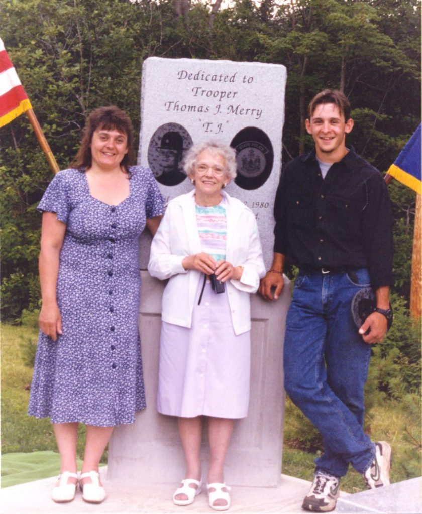 Trooper Thomas Merry's widow, Debbie; his mother, Erla; and his son, Ben, attend the dedication of a granite monument placed in Trooper Merry's honor in 1998. Nearly 200 people attended the dedication along U.S. Route 2 in Palmyra. Now the monument has been moved to a more visible site nearby.