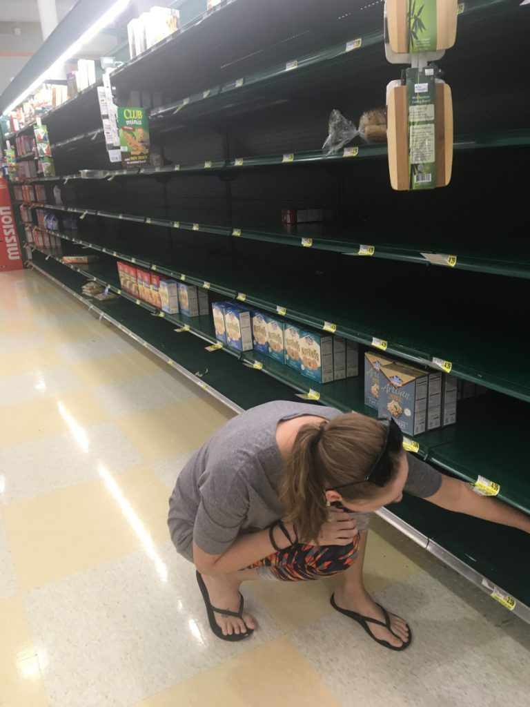 Kaylie Conti, who recently moved from Winslow to Wilmington, North Carolina, looks for crackers on a store shelf in Durham, North Carolina. She and her husband, along with their two dogs and a cat, evacuated from their Wilmington home to Durham to avoid the path of Hurricane Florence.