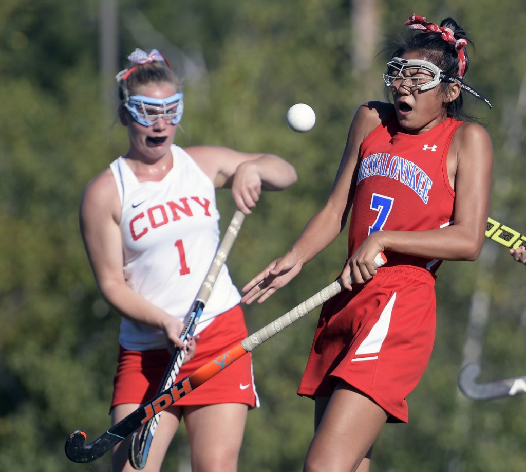 Cony's Alexis Couverette, left, and Messalonskee's Annie Corbett collide during a field hockey game Thursday in Augusta