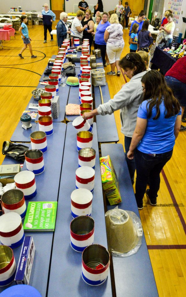 People try to decide into which bucket to put their Somerville Day raffle tickets Saturday at Somerville Elementary School.