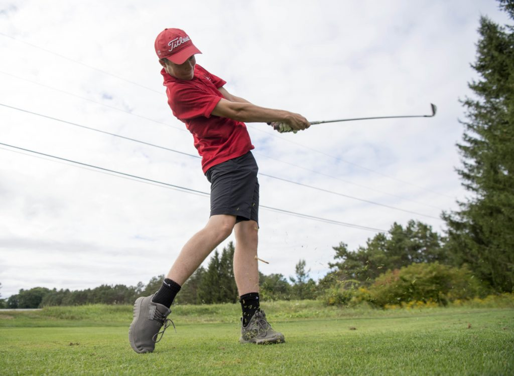 Cony golfer Kyle Douin hits a drive last week at Natanis Golf Course in Vassalboro.