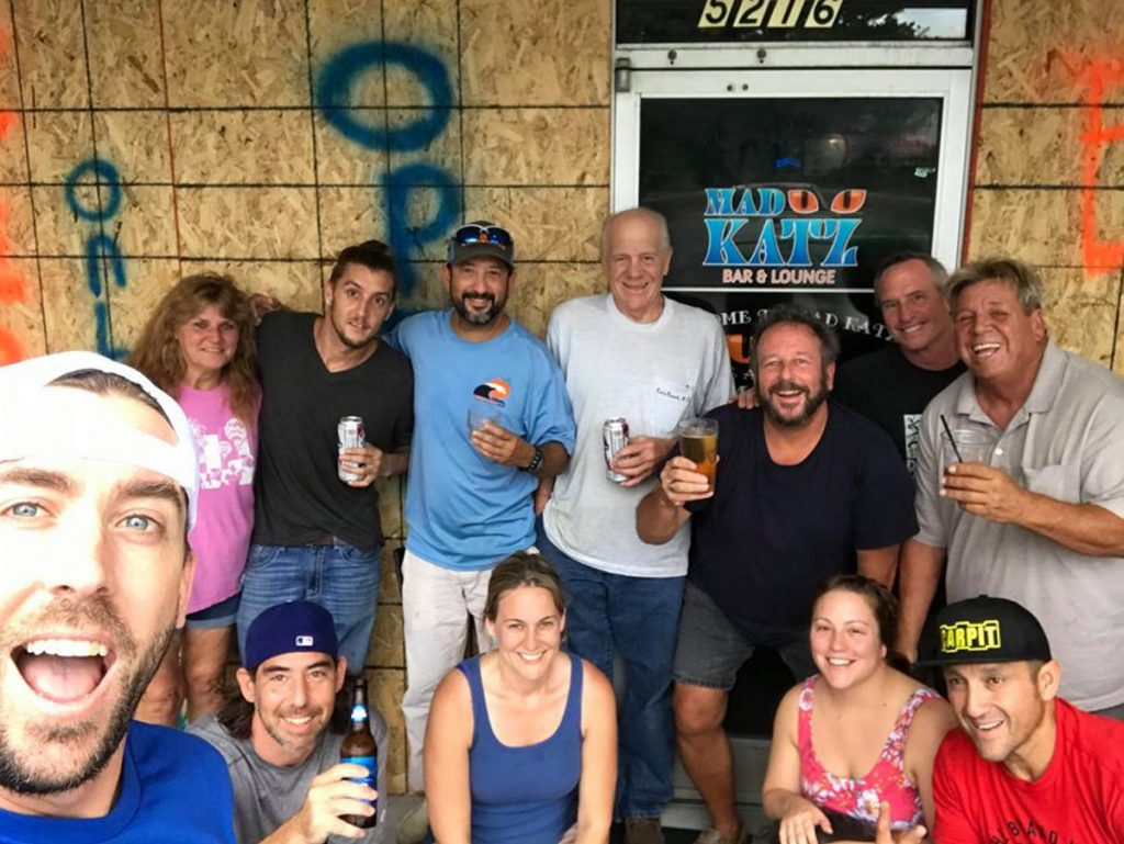 Tim Cramer, far left, a Waterville native, stands last week outside the Wilmington, North Carolina, bar where he now works, along with a group of customers. Cramer decided to stay in Wilmington even as Hurricane Florence was bearing down on the coastal city.
