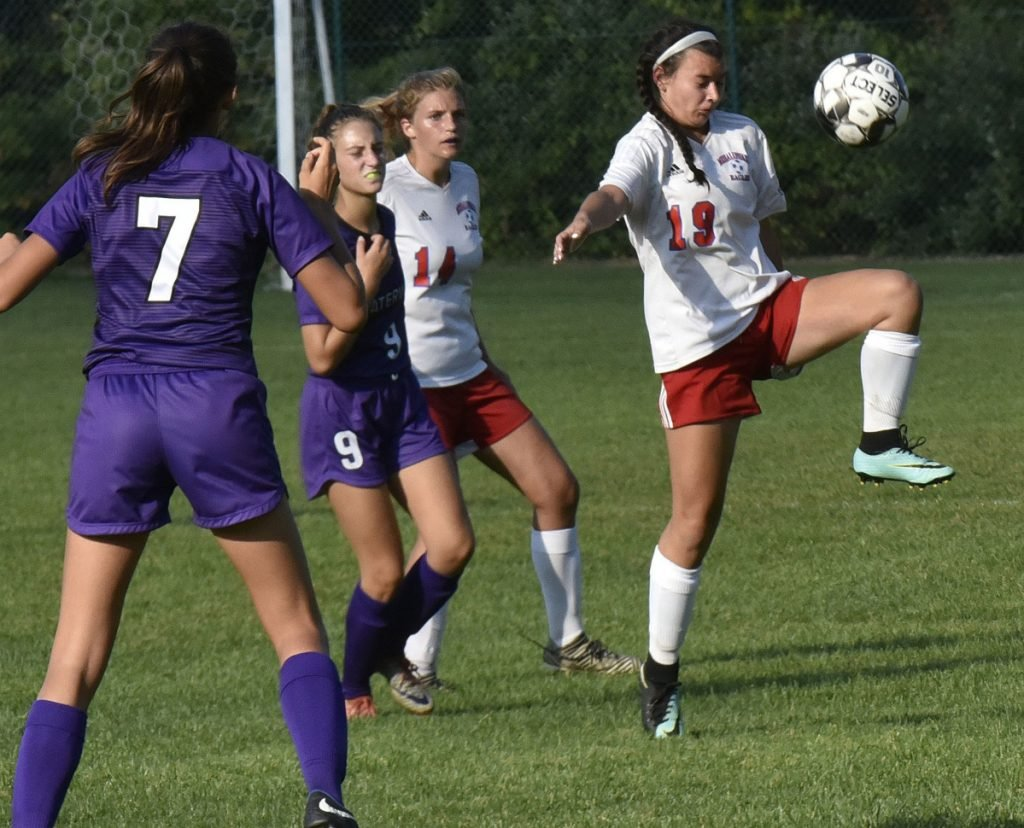 Messalonskee's Lily Wilkie knees the ball as Waterville's Sophia Poole, left, and Jess Bazakas pressure her during a game Tuesday in Waterville.