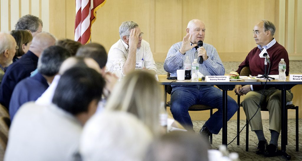 USDA Secretary Sonny Perdue, second from right, speaks during a roundtable discussion at Franklin Memorial Hospital in Farmington on Wednesday. U.S. Rep. Bruce Poliquin, R-Maine, is at right and Maine Department of Agriculture Commissioner Walter Whitcomb is to Perdue's left.