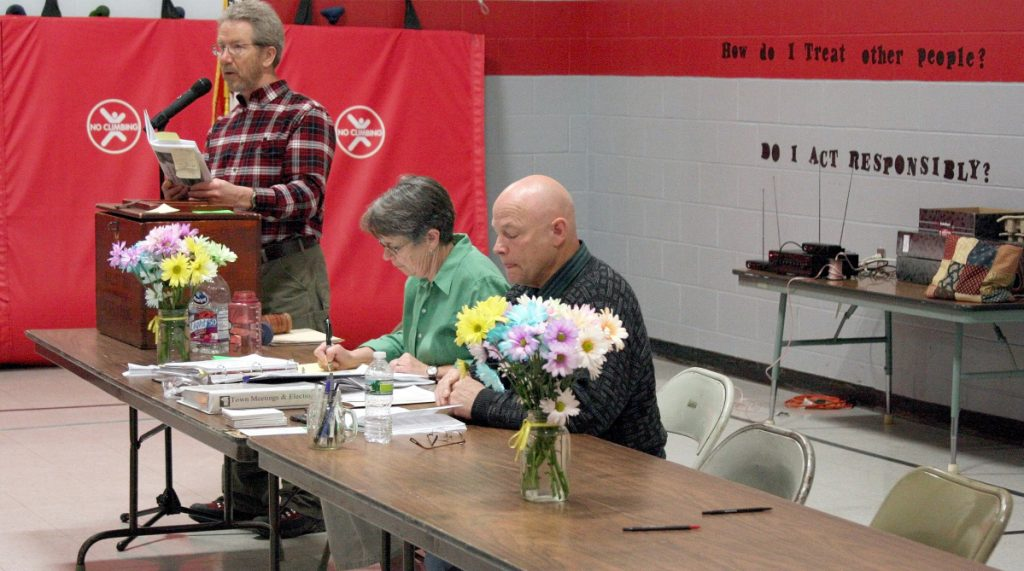 Moderator Don Newell, left, calls for a vote in March 2012 during Town Meeting in Unity, while Town Clerk Susan Lombard and newly elected Selectman Clement Blakney read along. Blakney died Thursday from injuries suffered in a crash in Unity.