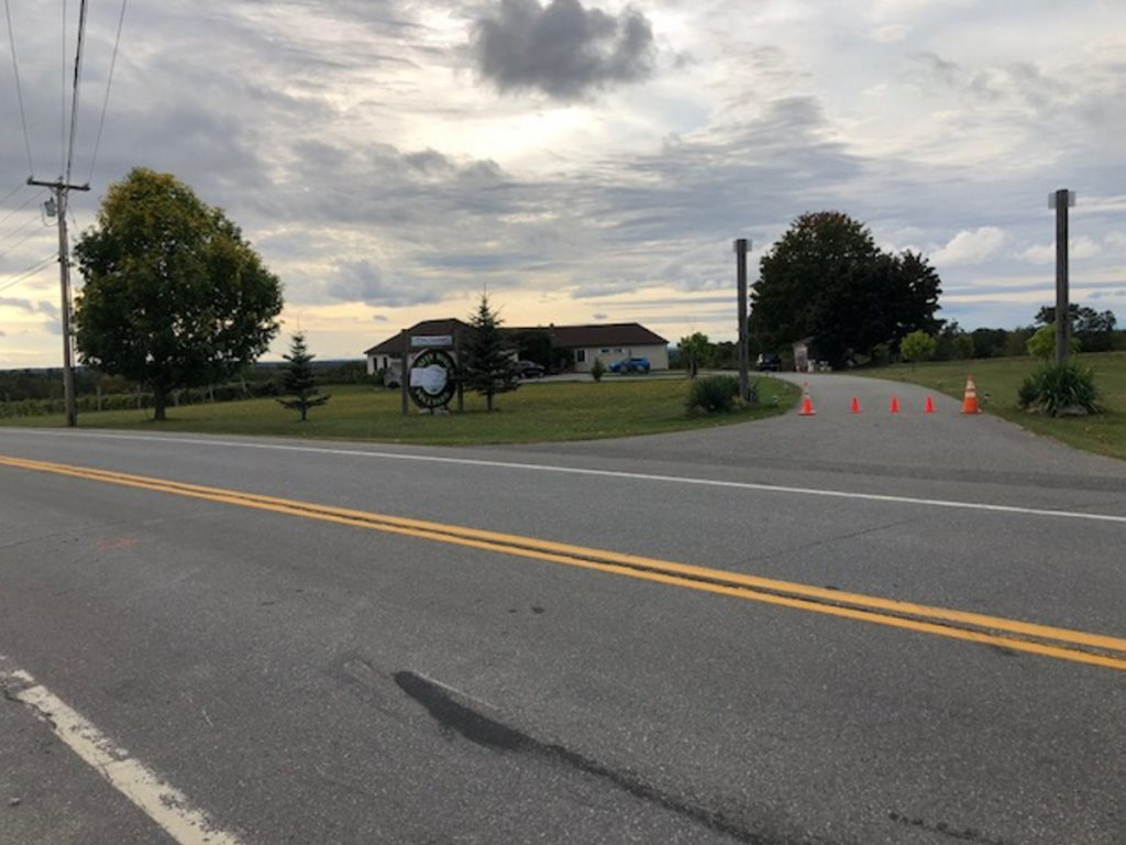 Orange traffic cones stand at the end of the driveway to Younity Winery and the Blakney home on Thursday, indicating the business is closed. A motorist killed Clement Blakney Wednesday in the area of the black mark, according to investigators.