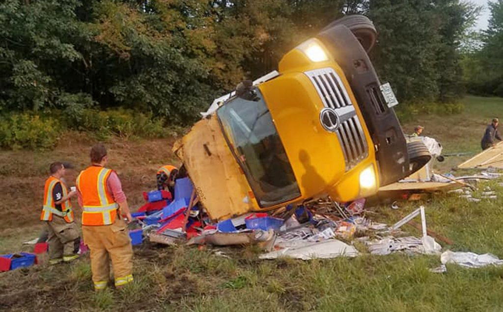 A driver suffered minor injuries after a truck carrying thousands of magazines crashed Thursday morning on the side of Interstate 295 in Richmond.