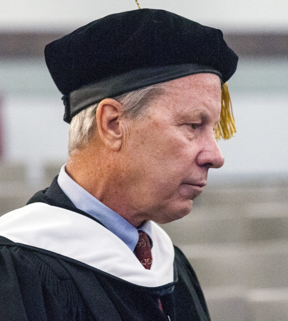 Keynote speaker Ben Bradlee Jr. appears before the annual University of Maine at Augusta convocation on Friday at the Augusta Civic Center.
