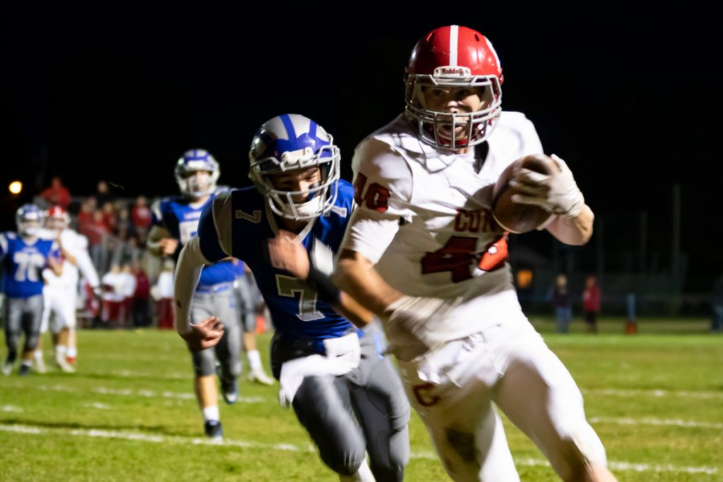 Cony's Matt Wozniak runs in for a touchdown against Lawrence on Friday in Fairfield.