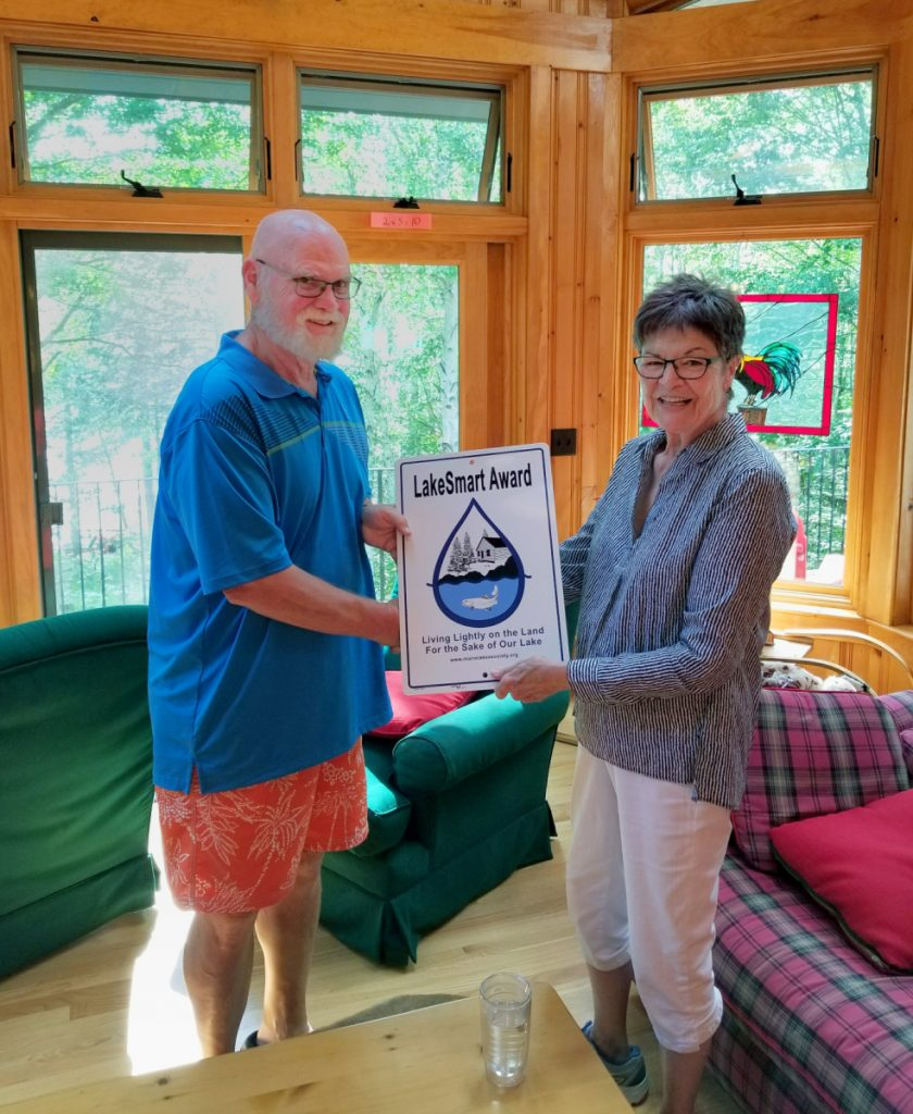 Maggie Shannon, right, presents the LakeSmart award to Earl Sasser, of Pleasant Lake in Otisfield.