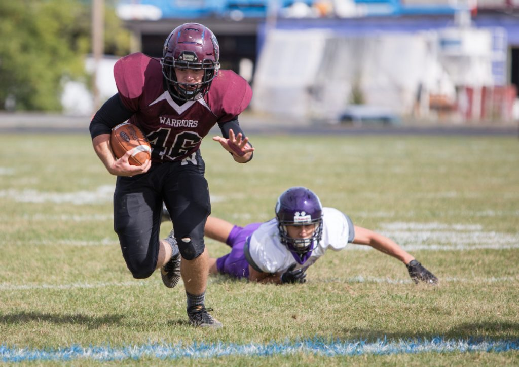 Nokomis running back Alex Costedio heads upfield as Waterville defender can Nicholas Wildhaber can only watch during a Class C North game Saturday in Newport.