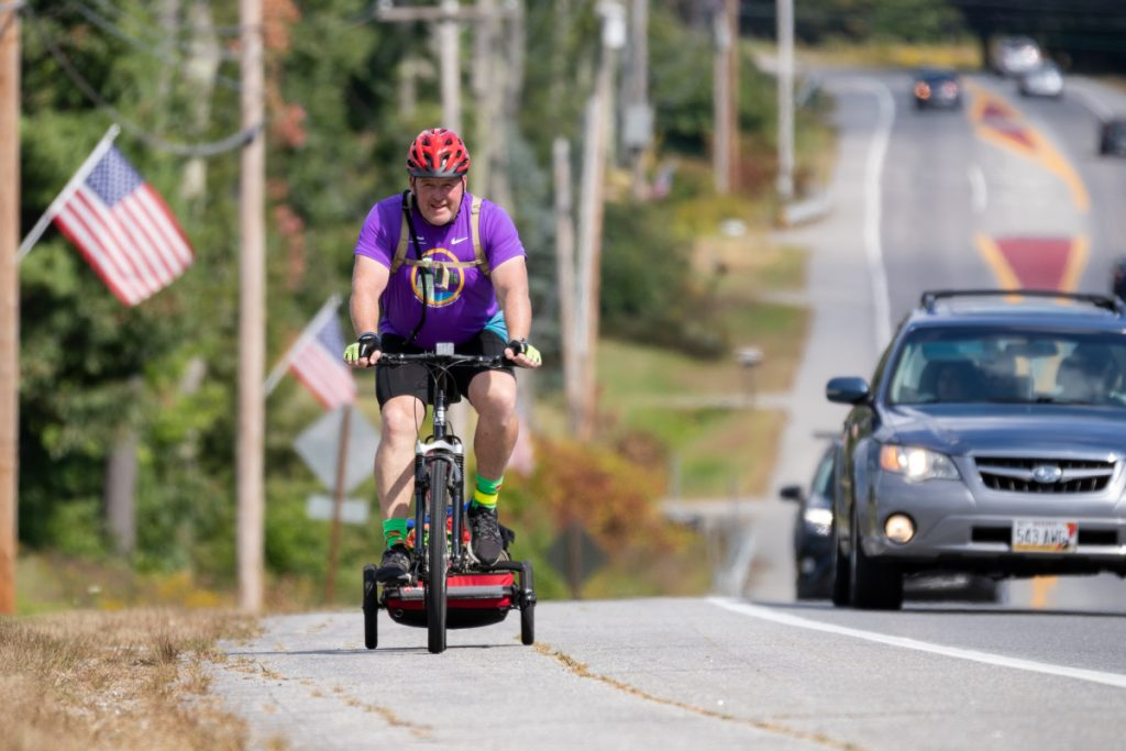 Brian McCarthy peddles up a hill on U.S. Route 1 in Wiscasset on Sept. 16, the sixth day of his ride from Houlton to raise money for the Family Readiness Group of the 488th Military Police Company based in Waterville.