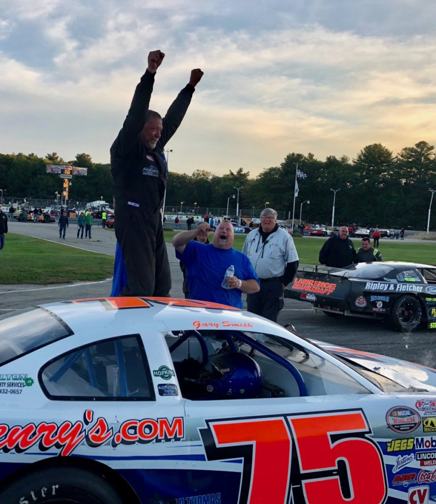 Gary Smith of Bangor raises his hands into the air in victory lane after winning the Pro All Stars Series 150 at Beech Ridge Motor Speedway in Scarborough on Sunday.