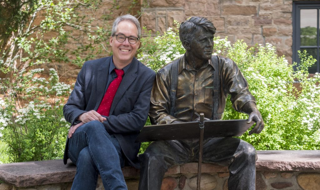 Chuck Plunkett, former editorial page editor for the Denver Post, takes a seat alongside a statue of Robert Frost on the campus of the University of Colorado Boulder where he has joined the College of Media, Communication and Information as director of CU News Corps, an investigative and explanatory news project.
