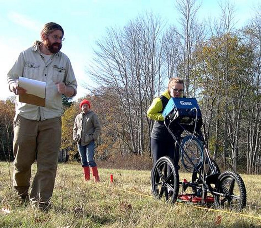 Andy Heller, left, with Alice Kelley and Jacque Miller conduct GPR survey.